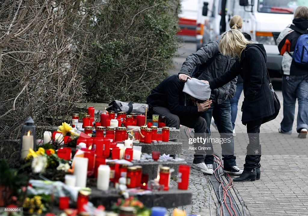 Two children comfort a friend as they mourn in front of the AlbertvilleSchool Centre on March 12 2009 in Winnenden near Stuttgart Germany 17 year old...