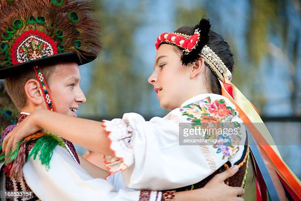 Two children dancing in traditional outfits