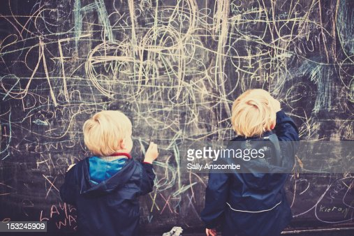 Two children drawing on board : Stock Photo