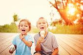 Two children eating ice cream cones
