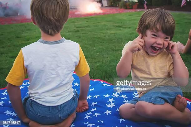 Two children enjoying fireworks display