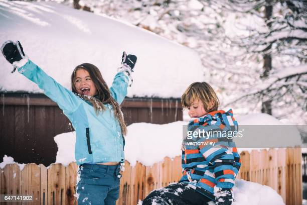 Two children excited about the snow