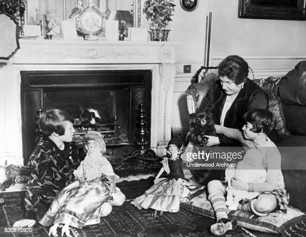 Two children from Chicago who were adopted by the Marchioness of Huntly play with their dolls in their new home in Grosvenor Square London England...