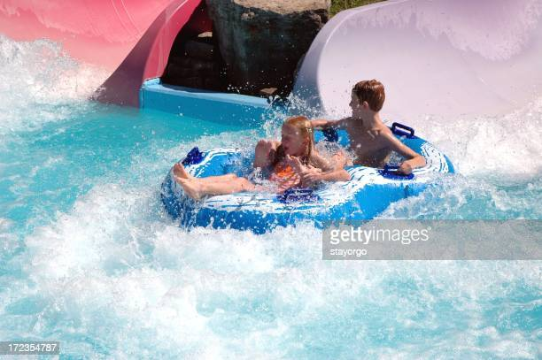 Two children going down a water slide