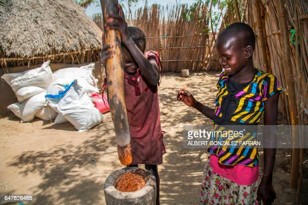 Two children ground cereals from a food distribution on March 4 in Ganyiel Panyijiar county in South Sudan South Sudan was declared the site of the...