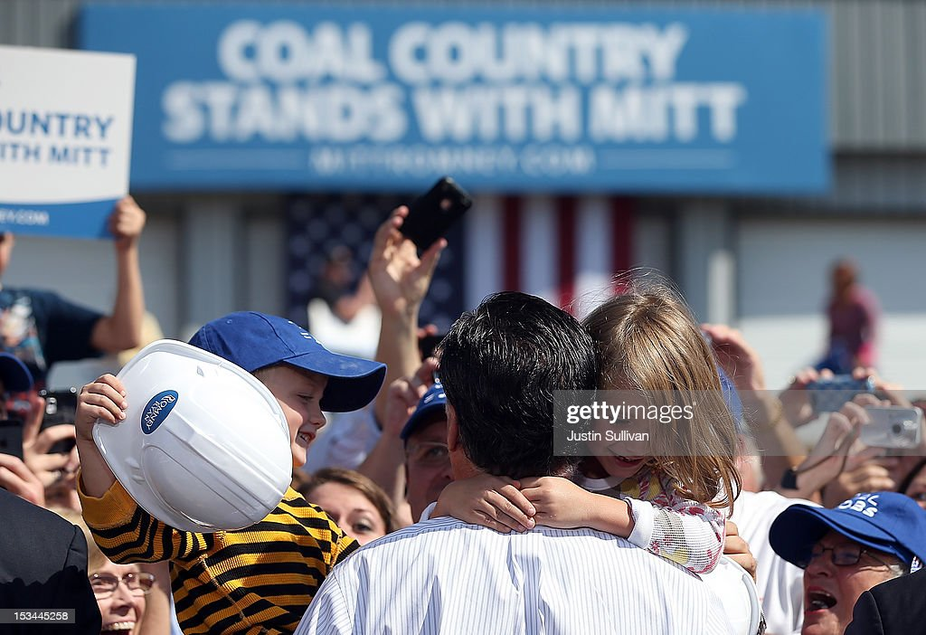 Two children hug Republican presidential candidate, former Massachusetts Gov. <a gi-track='captionPersonalityLinkClicked' href=/galleries/search?phrase=Mitt+Romney&family=editorial&specificpeople=207106 ng-click='$event.stopPropagation()'>Mitt Romney</a> during a campaign rally on October 5, 2012 in Abingdon, Viriginia. <a gi-track='captionPersonalityLinkClicked' href=/galleries/search?phrase=Mitt+Romney&family=editorial&specificpeople=207106 ng-click='$event.stopPropagation()'>Mitt Romney</a> is campaigning in Virginia coal country and Florida.