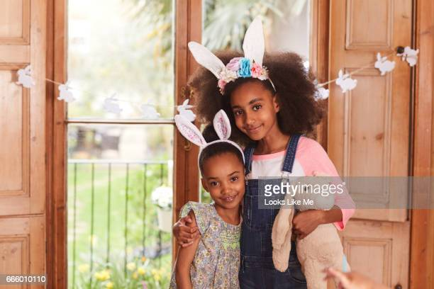 Two children hugging wearing Easter bunny ears