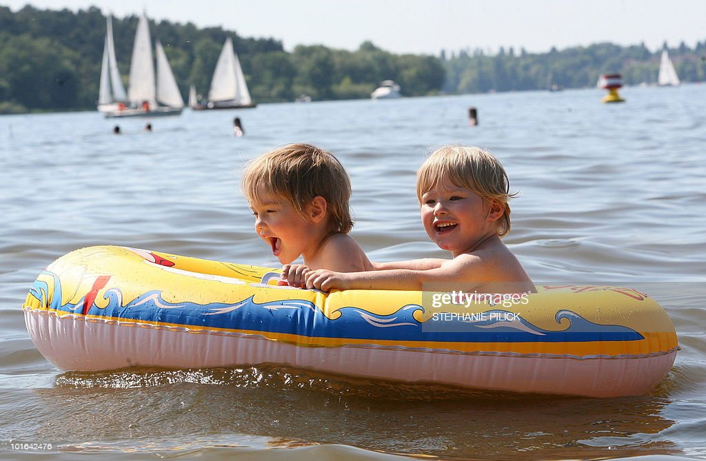 Two children in a rubber boat enjoy a cruise on the Wannsee lake near Berlin on June 5, 2010. Spring brought warm and sunny weather to wide parts of the country.