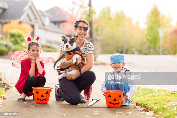Two Children in Halloween Costumes Trick or Treating