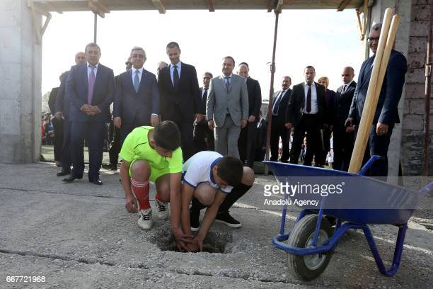 Two children lay the first brick as UEFA President Aleksander Ceferin Armenian President Serzh Sargsyan and Football Federation of Armenia President...