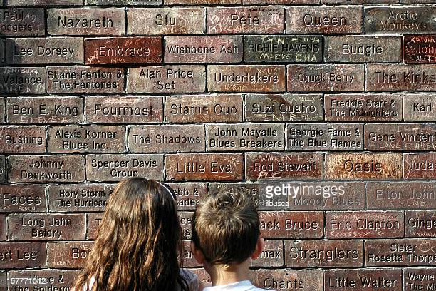 Two children looking at the Cavern Wall of Fame