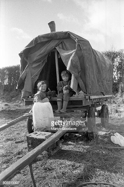 Two children of New Age travellers on a gipsy caravan at an encampment near Hereford 1987