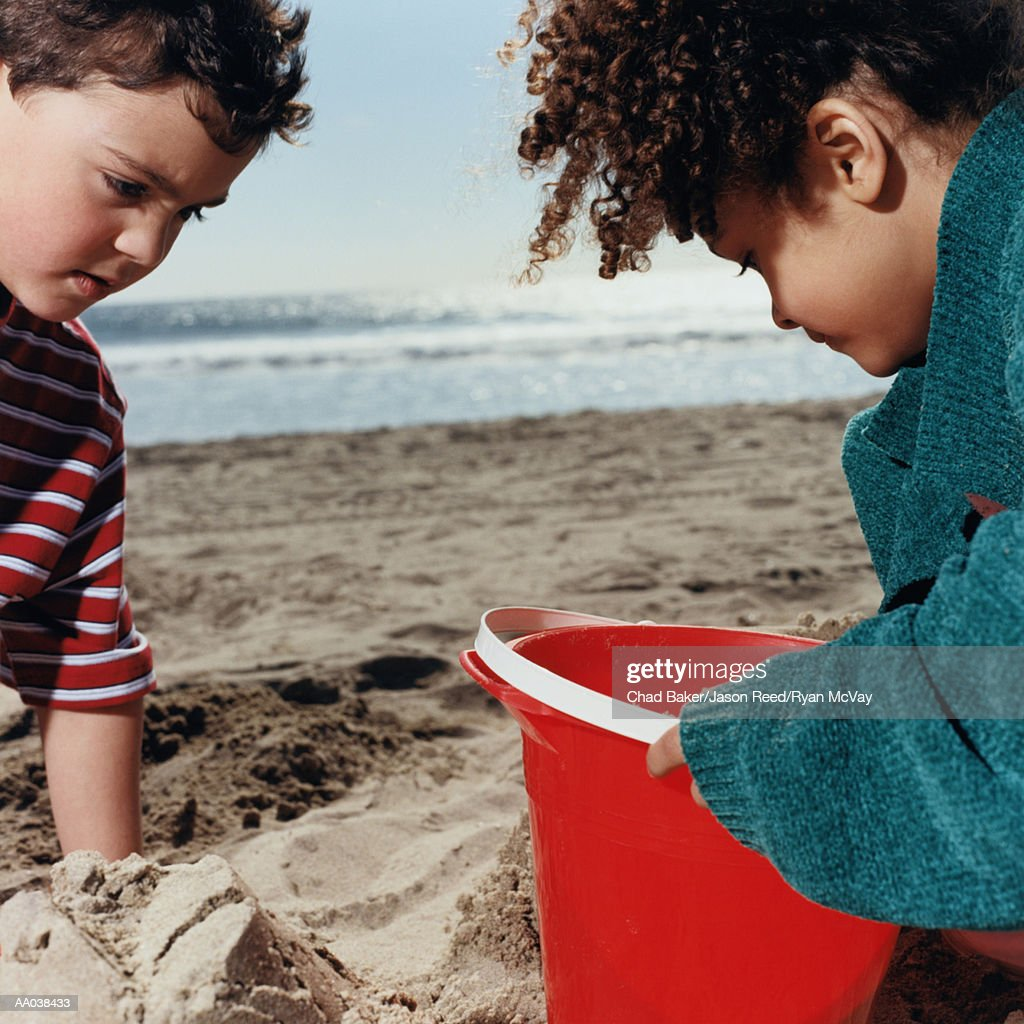 Two Children Playing on the Beach : Stock Photo