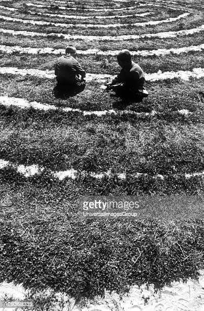 Two children playing on the ground Big Green gathering UK 1990's