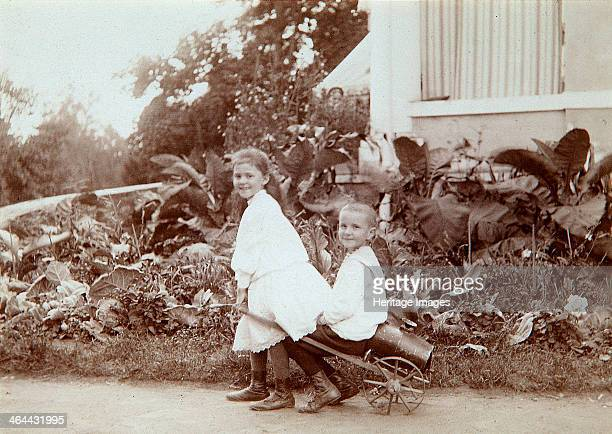 Two children playing outdoors 1890s Found in the collection of the State Museum of History Moscow