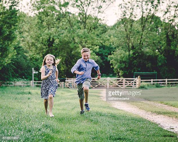 Two children racing each other in a field