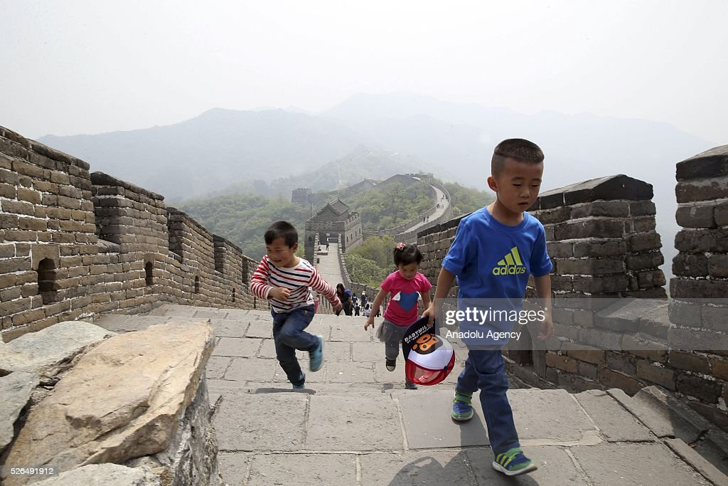 Two children run as one of them walks on a section of the Great Wall of China in Beijing, China on April 30, 2016.