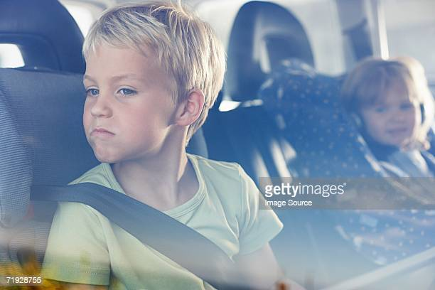 Two children sat in the back of car