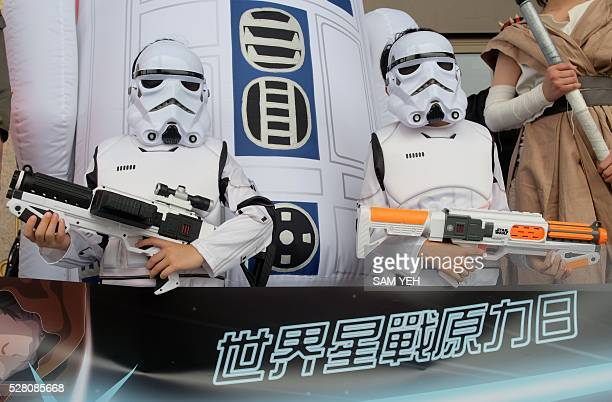 Two children strike a pose dressed as the Star Wars white knights during the annual Star Wars Day in Taipei on May 4 2016 Some 100 star wars fans...