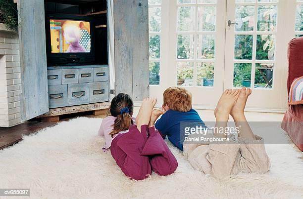 Two Children Watching Television