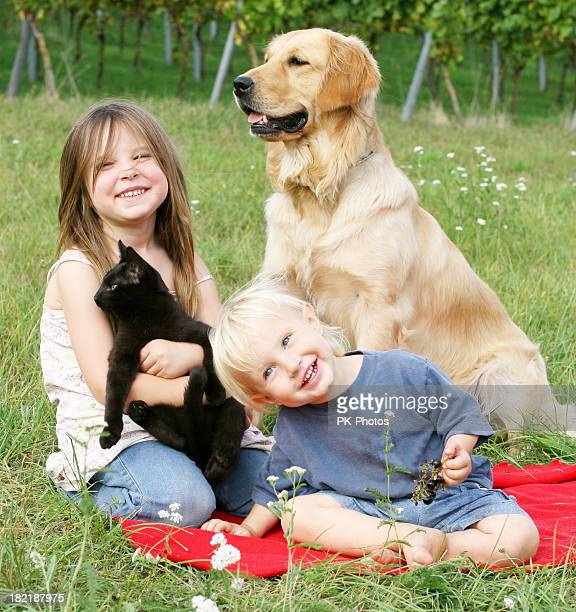Two children with dog and cat