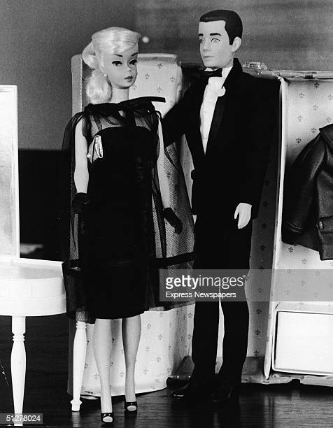 Two children's dolls Barbie and Ken in formal wear stand together in front of a toy closet December 15 1964