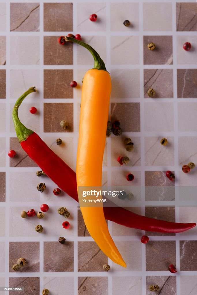 Two chili peppers on ceramic tile : Stockfoto
