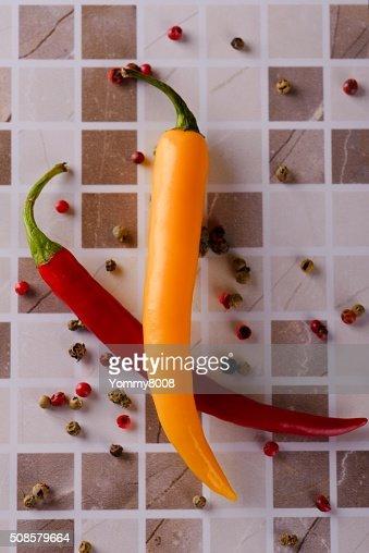 Two chili peppers on ceramic tile : Bildbanksbilder