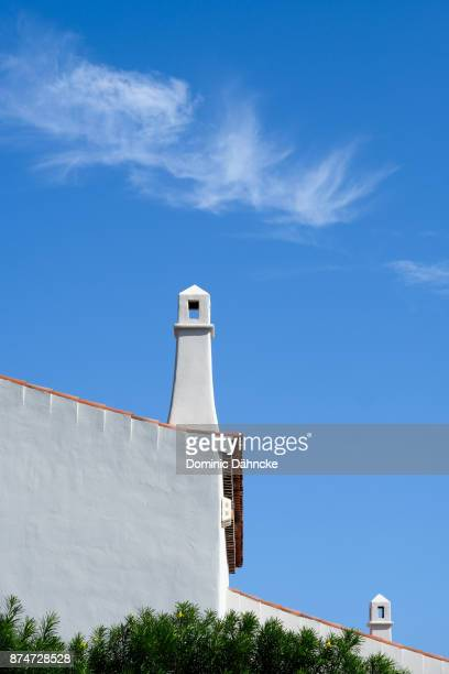 Two chimneys with blue sky