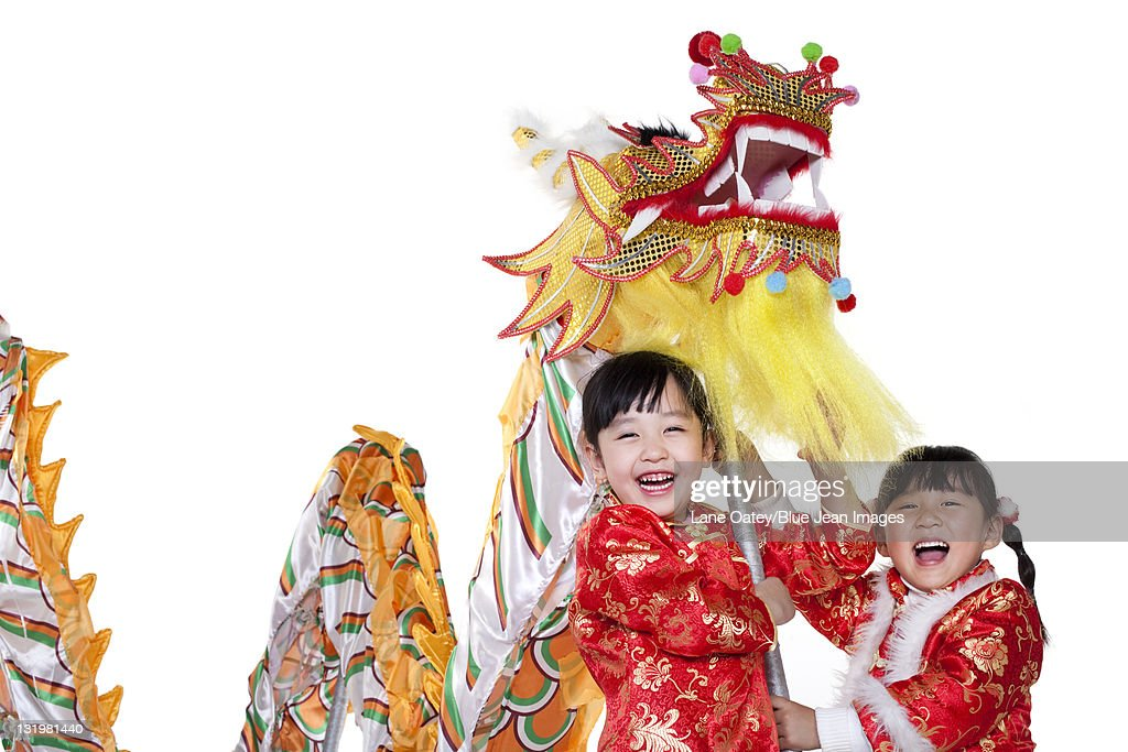 two chinese girls holding chinese dragon stock photo