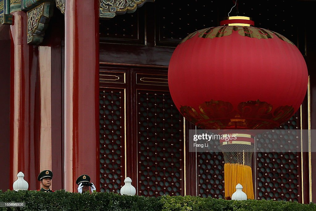 Two Chinese paramilitary policemen monitor the square with telescope on the Tiananmen Gate on November 7, 2012 in Beijing, China. The18th National Congress of the Communist Party of China (CPC) is proposed to convene on November 8 in Beijing.