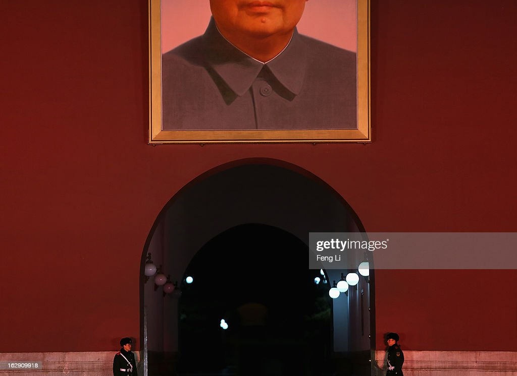 Two Chinese policemen guard under a giant portrait of the late chairman Mao Zedong on the Tiananmen Gate on March 1, 2013 in Beijing, China. The reshuffle will be completed at the first annual session of the 12th National People's Congress (NPC), which is scheduled to begin on March 5, and the first annual session of the 12th National Committee of the Chinese People's Political Consultative Conference (CPPCC), which will commence on March 3.