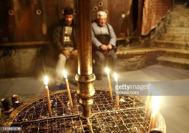 Two Christian pilgrims pray in the Church of Nativity Grotto believed to be the birth place of Jesus Christ in the West Bank town of Bethlehem 20...
