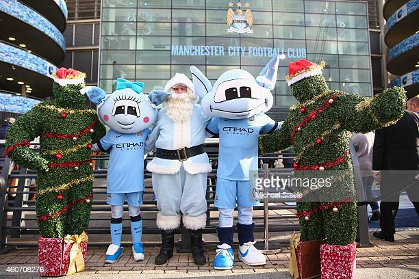 Two christmas trees Moonbeam Moonchester and Santa Claus pose outside the players entrance during the Barclays Premier League match between...