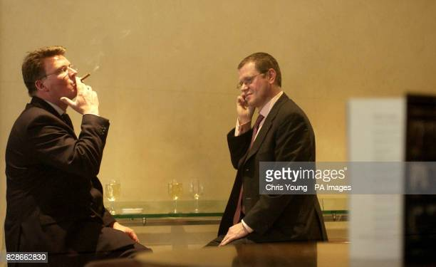 Two City workers relax in a bar near the London Stock Exchange as reaction spreads to Gordon Brown's budget As expected Gordon Brown once again...