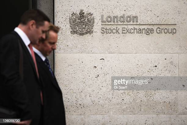 Two city workers walk past the London Stock Exchange on September 22 2011 in London England Share prices on world stock markets have fallen sharply...