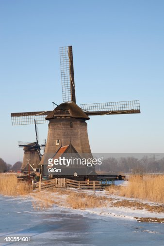 Two classic windmills in winter with blue sky : Stock Photo