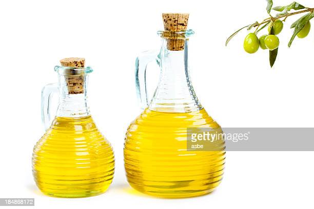 Two clear bottles filled with olive oil