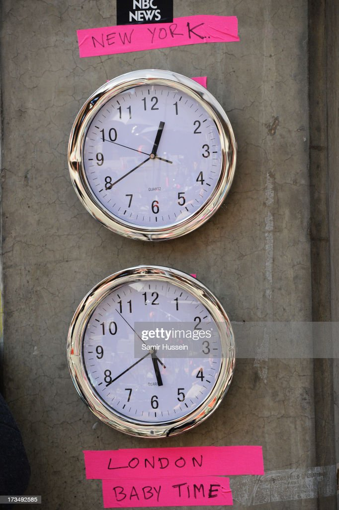 Two clocks attached to a piller to indicate the time in London and New York for the media who are waiting outside the The Lindo Wing of St Mary's Hospital as the UK prepares for the birth of the first child of The Duke and Duchess of Cambridge at St Mary's Hospital on July 15, 2013 in London, England.