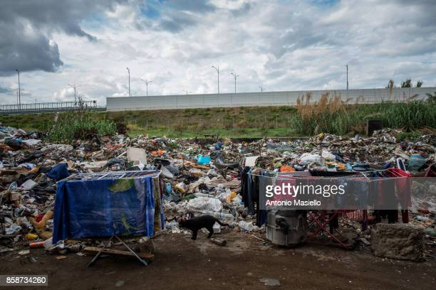 Two clotheshorses stand next to a pile of refuse outside an occupied building on October 4 2017 in Rome Italy For the last 5 years hundreds of people...