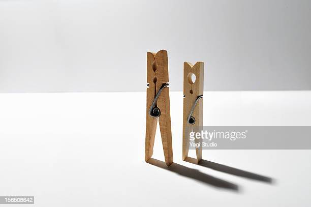 Two clothespins standing