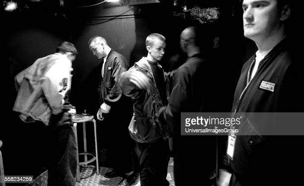 Two clubbers being searched by members of security by the main doors of the Hacienda Manchester early 1990's