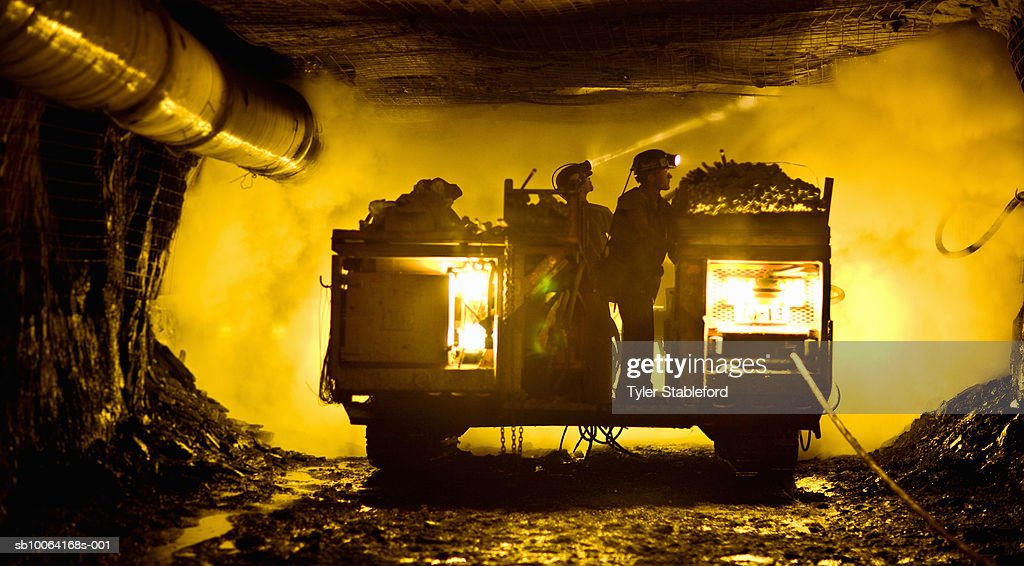 Two coal miners in mine shaft : Stock Photo