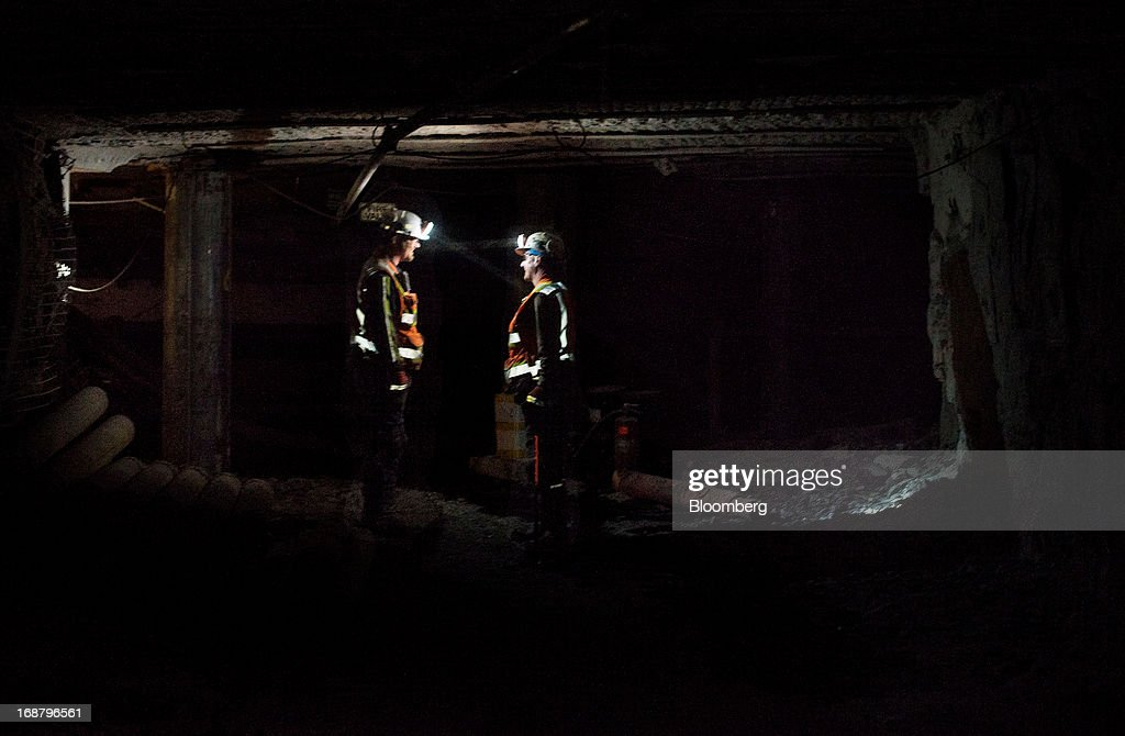 Two coal miners wearing head lamps confer inside a tunnel at the Consol Energy Bailey Mine in Wind Ridge, Pennsylvania, U.S., on Tuesday, May 14, 2013. Coal's prospects are improving after its share of U.S. power generation fell last year to 34 percent, the lowest since at least 1973, Energy Department data show. Hotter temperatures this summer that prompt American households to use more air conditioning will boost demand for coal and the railroads that ship it. Photographer: Ty Wright/Bloomberg via Getty Images