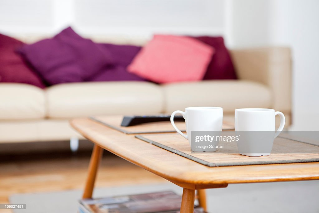 Two coffee cups on coffee table