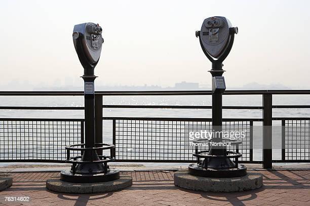 Two coin operated binoculars on promenade