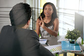 Boss business woman giving orders to an employee during a a work conflict