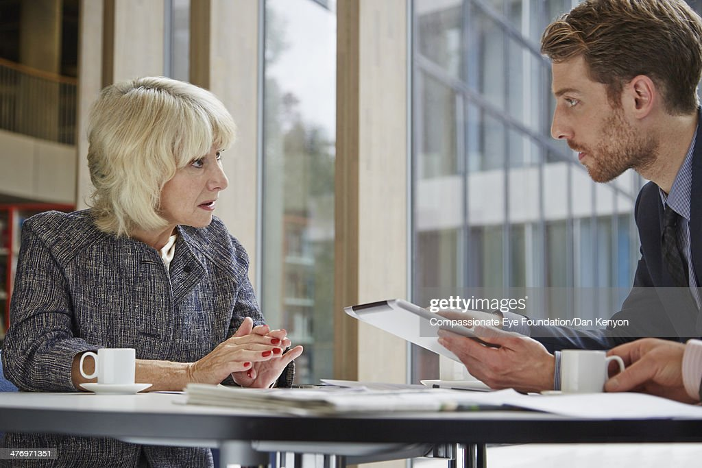 Two colleagues in conversation in meeting : Stock Photo