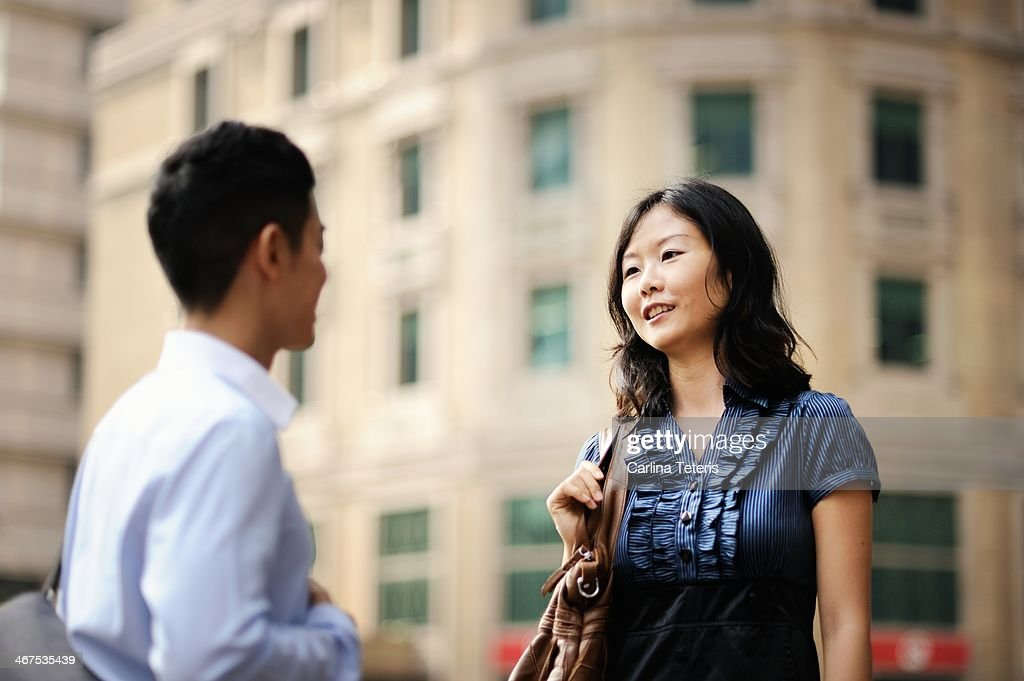 Two colleagues talking outside : Stock Photo