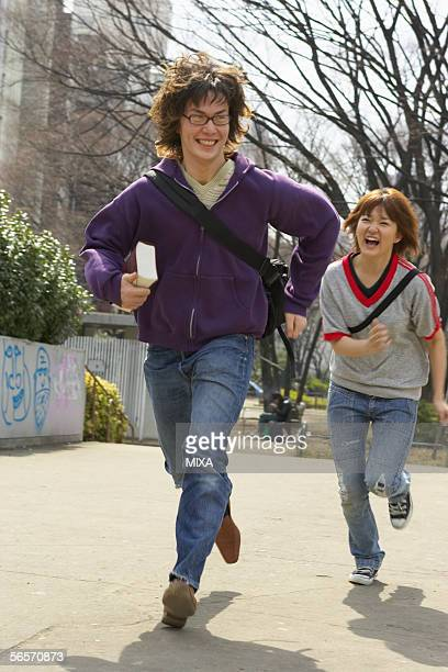 Two college students running